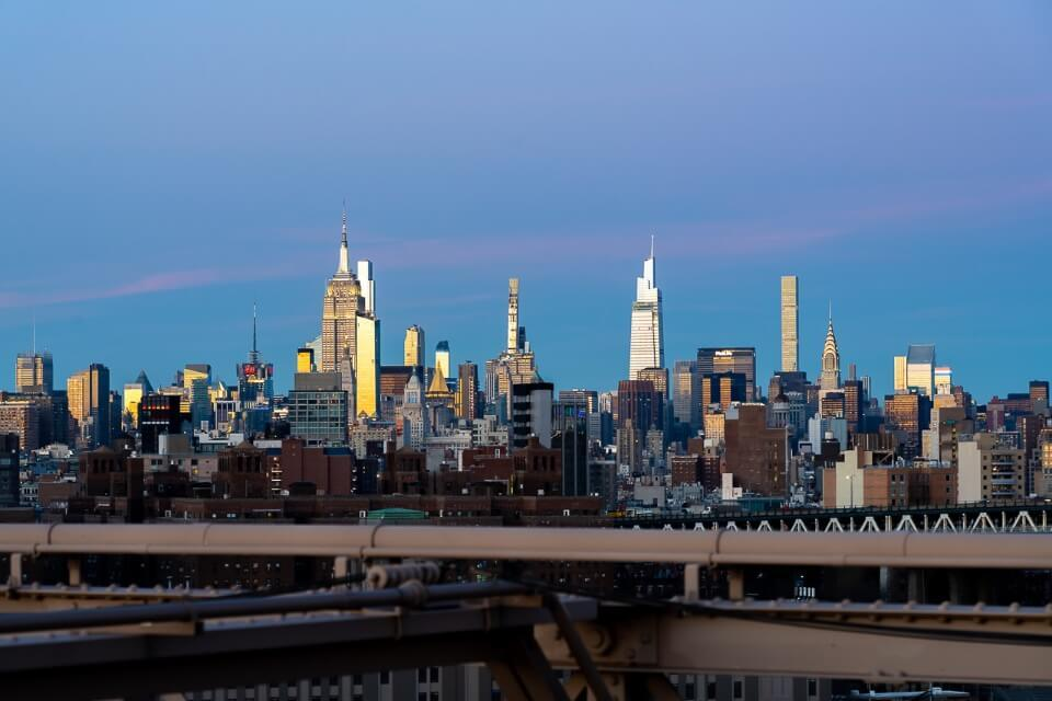Midtown manhattan and empire state building at dusk with blue and purple sky