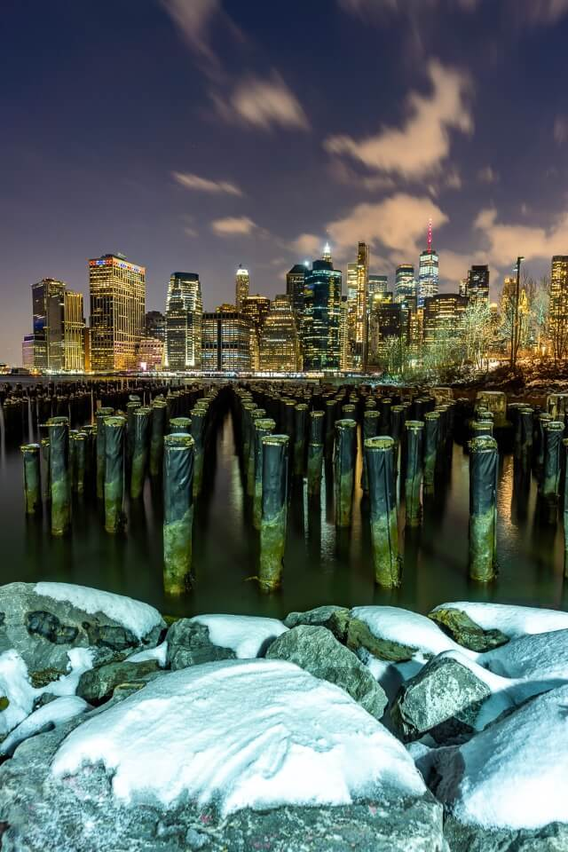 Old pier 1 new york city photography in winter with snow on rocks