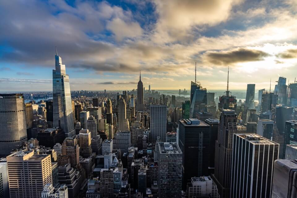 Awesome view over Manhattan at sunset from top of the rock observation deck as part of the new york CityPASS and c3 pass attractions list