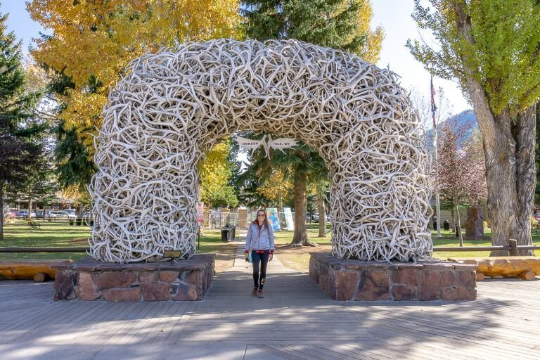 Woman underneath antler arch in Jackson wyoming