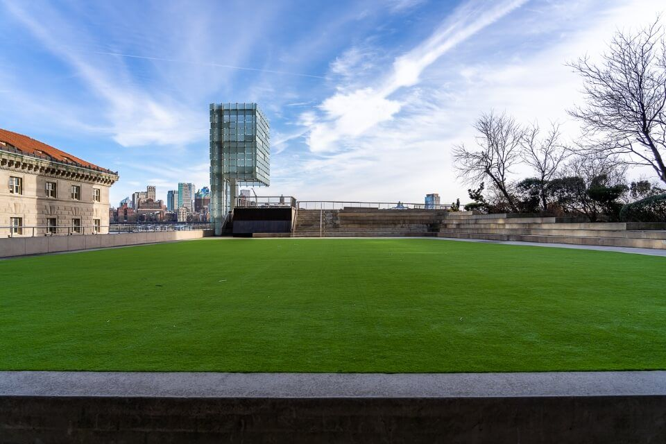 Elevated Acre artificial grass on the first level of a building overlooking brooklyn in new york city