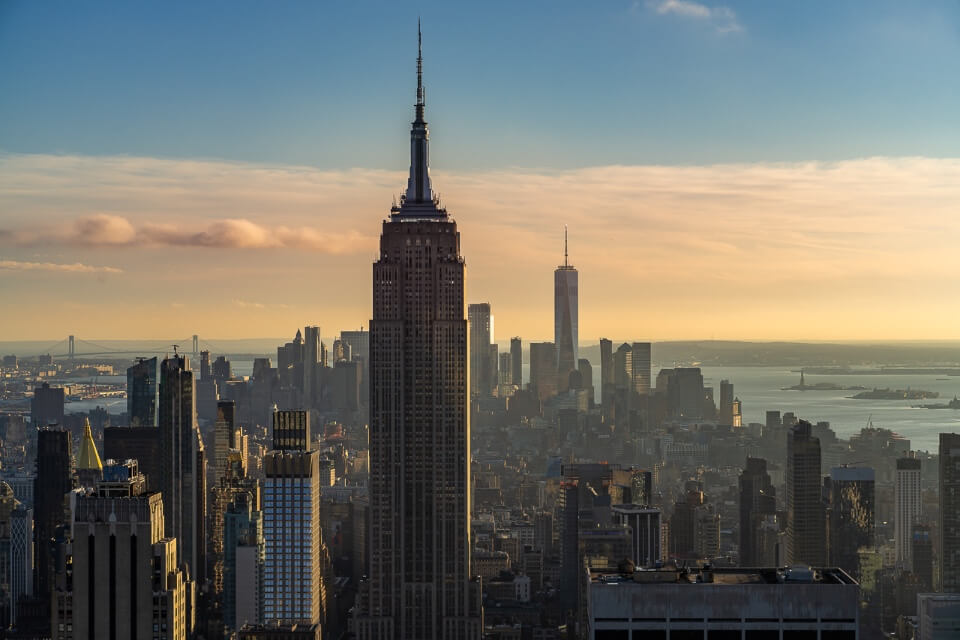 Empire State Building seen from Top of the Rock on the Rockefeller Center in New York City with One World Observatory in the background