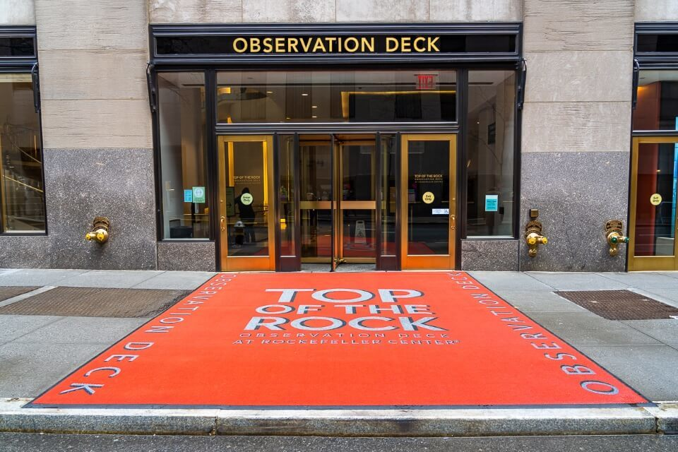 Red carpet entrance with ornate revolving doors top of the rock
