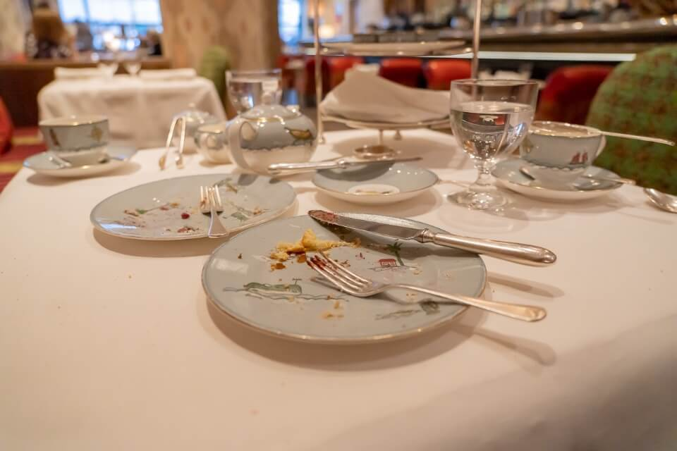 Empty plates with crumbs at a hotel in new york city