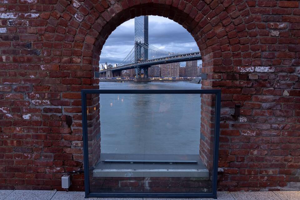 Manhattan Bridge through a window in Time Out Market New York City