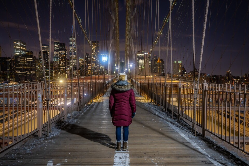 Where are those morgans walking over the brooklyn bridge at night