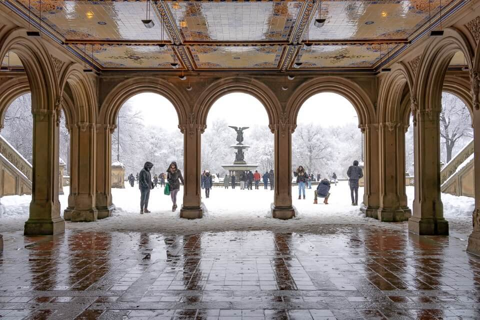 Bethesda Terrace busy with tourists and locals on a snow day in Winter