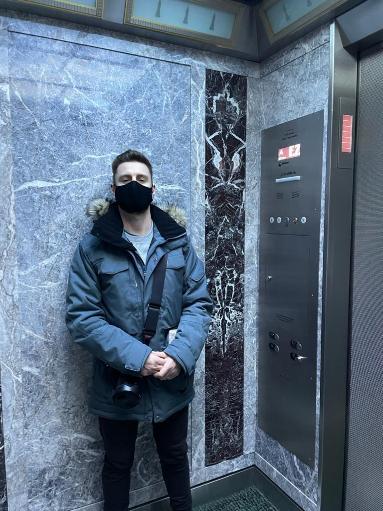 Man in elevator with mask on