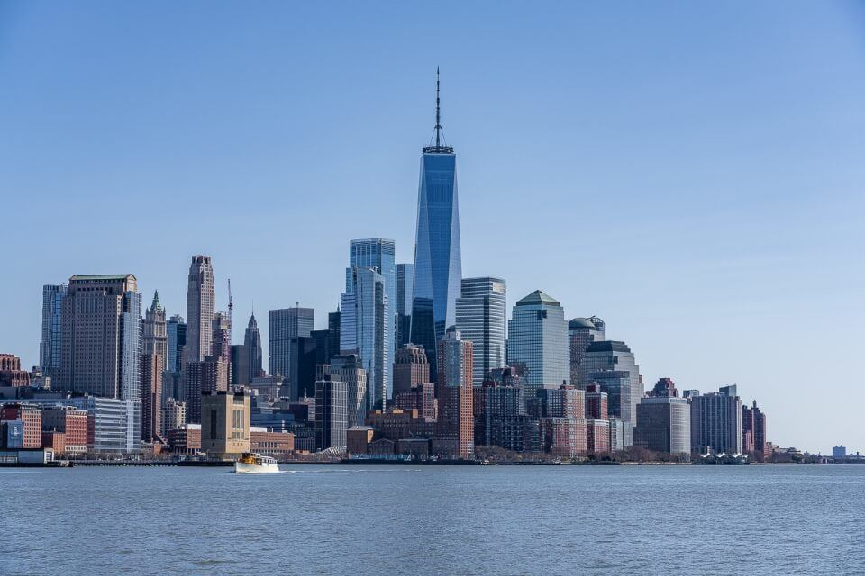 Lower Manhattan with one world trade center from circle line boat tour in Hudson River