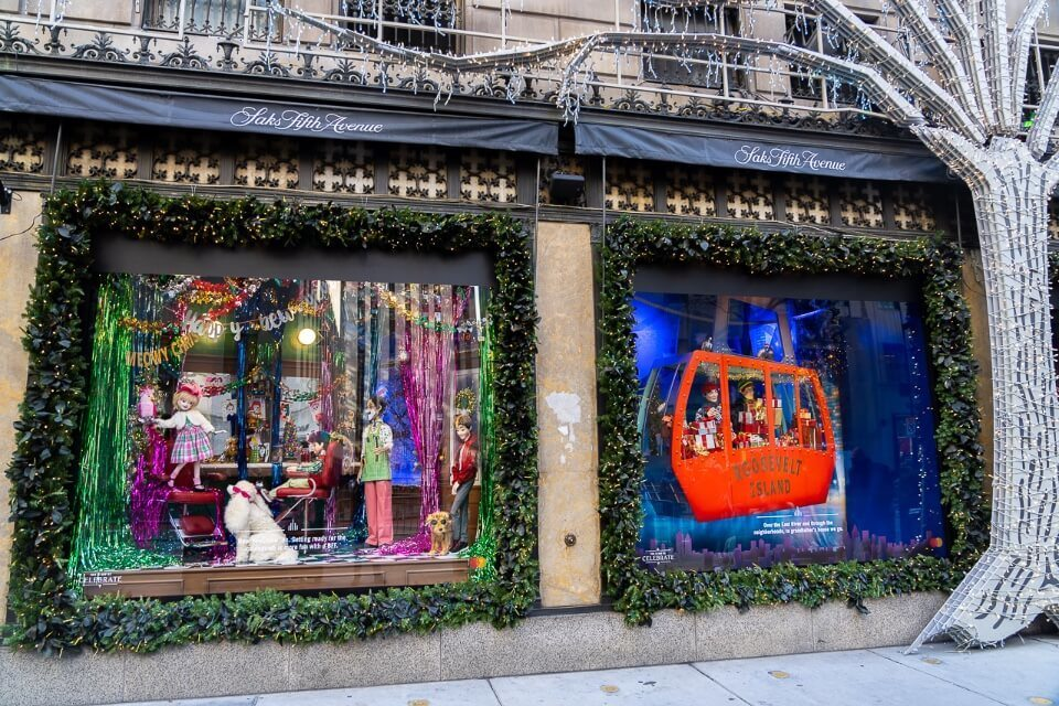 Saks fifth avenue at christmas displaying exhibits in window