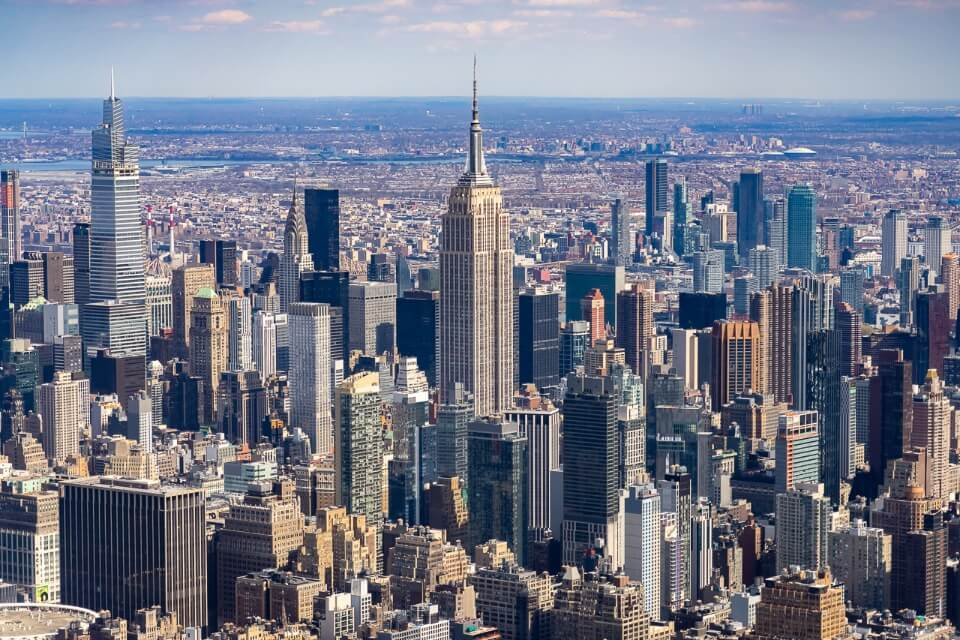 Empire state building and midtown manhattan photograph taken from a helicopter tour over NYC is an amazing photography opportunity