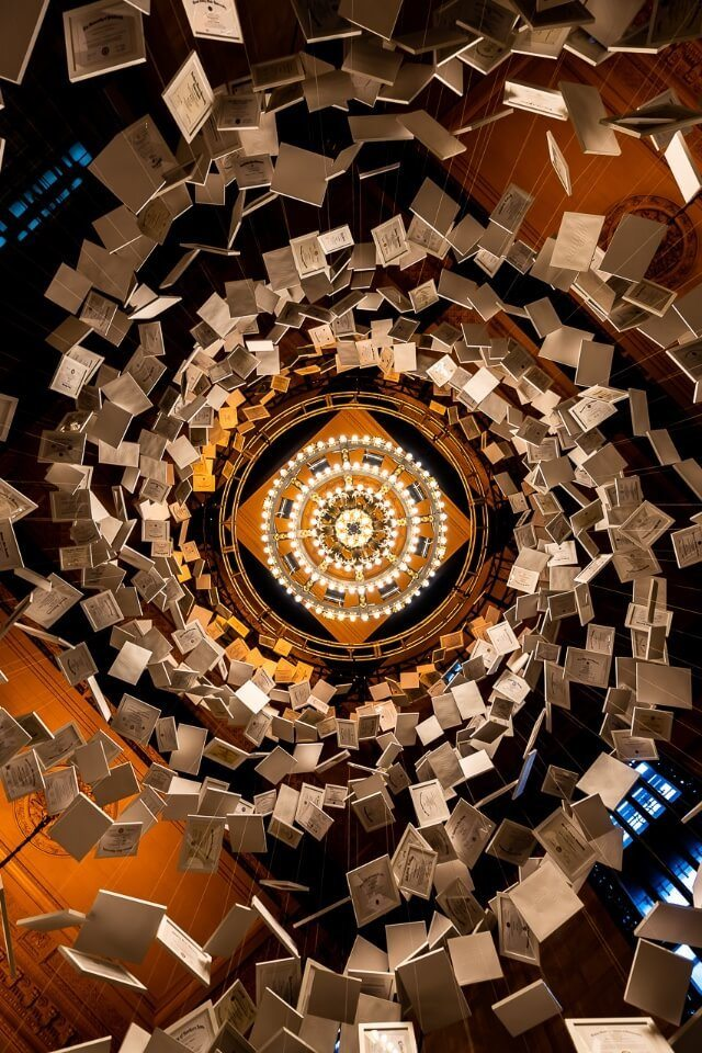 Looking directly up through a spiral of paper in suspension in grand central station new york city