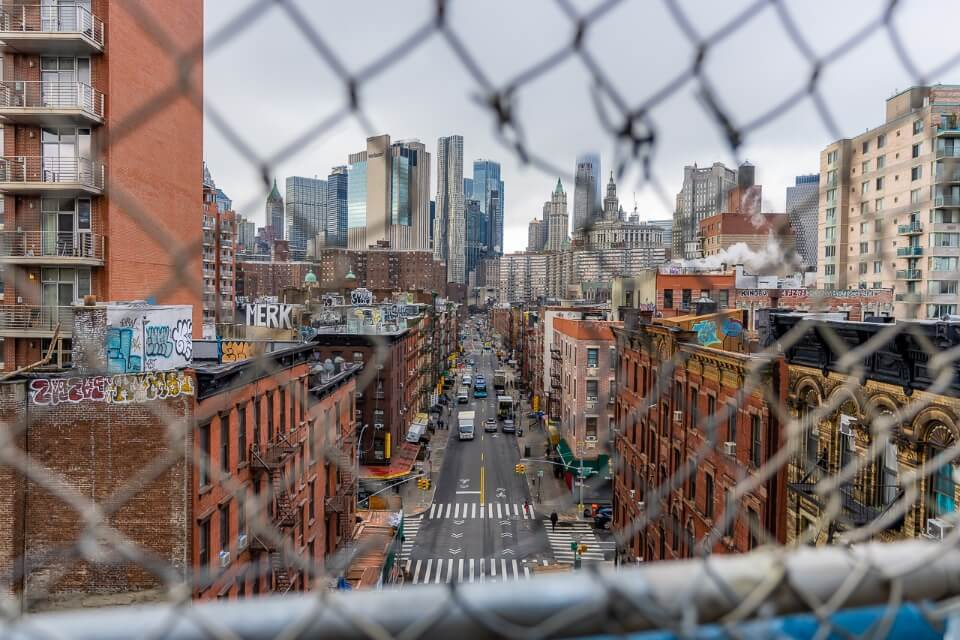 Hole in Fence famous photograph taken from Manhattan Bridge of Chinatown in NYC