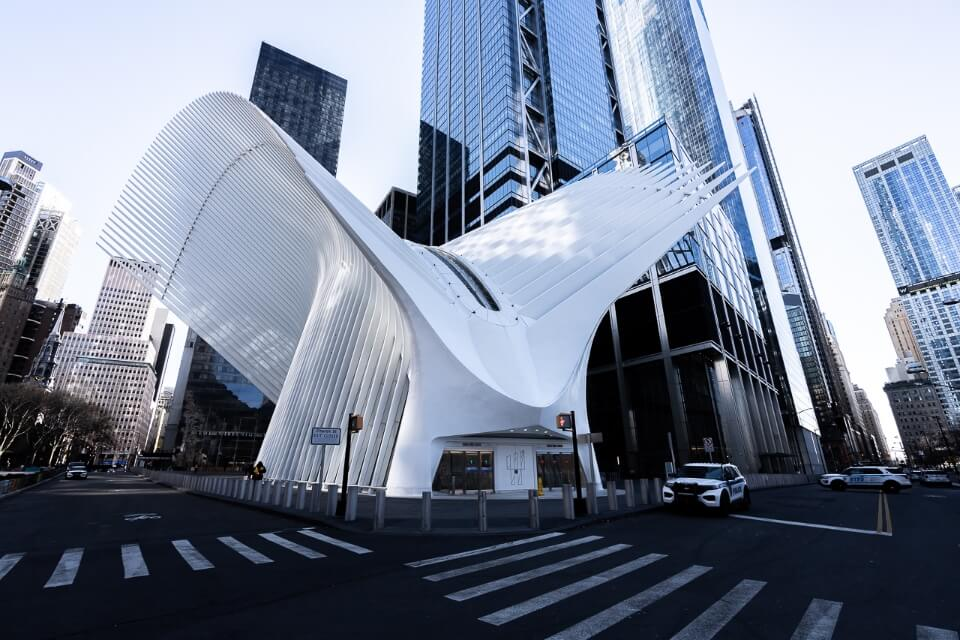 Oculus is a unique new york city photography location with dove like wings and surrounded by tall glass buildings
