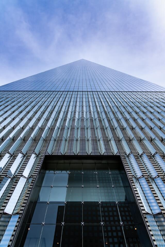 One world trade center from the base looking up it looks like a pyramid at the top