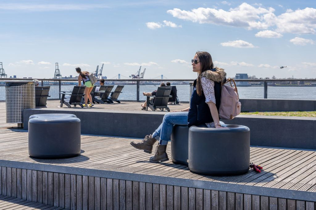 Pier 15 two story decking area open to public offers great views over East river and brooklyn with plenty of places to sit and relax