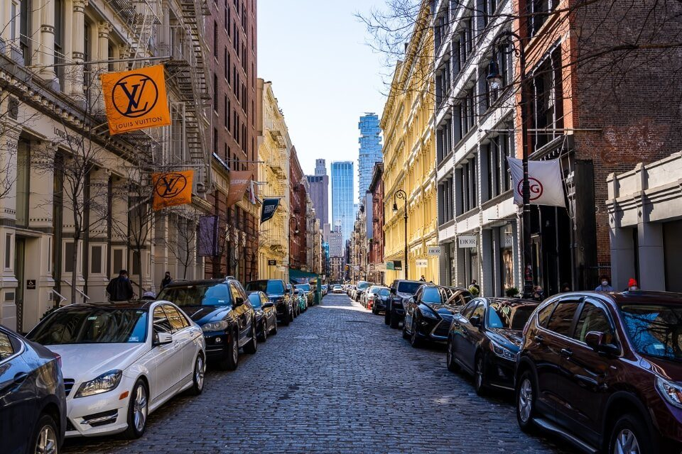 SoHo is a very attractive and photogenic area to photograph around new york city with colorful buildings and cobblestone streets