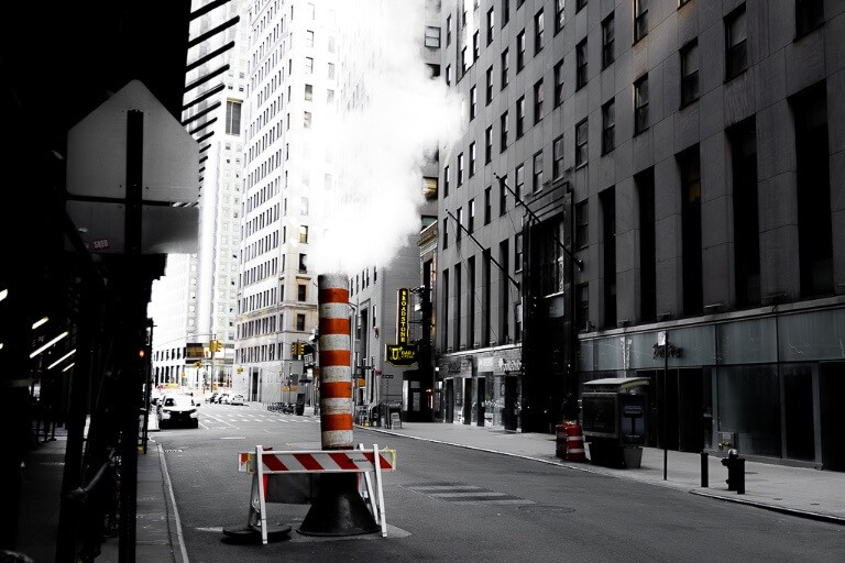 Smoke stack with steam coming out of subways in new york city makes for awesome and unique photography