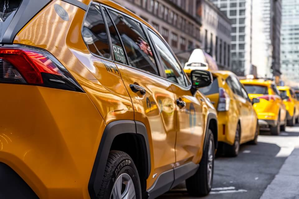 Classic and iconic yellow taxi photograph taken outside grand central station