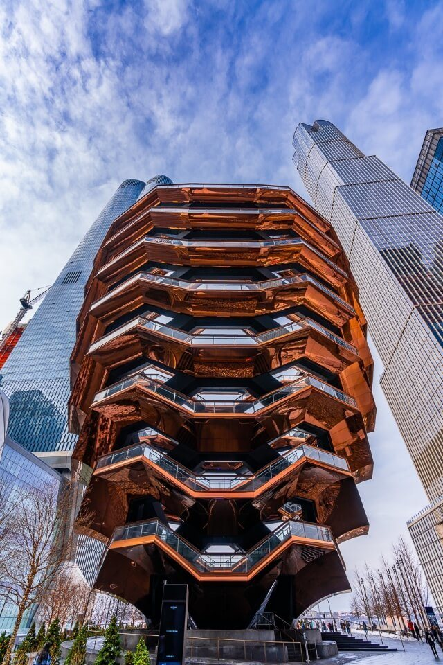Vessel is among the best photography locations in NYC stunning architecture with tall buildings behind