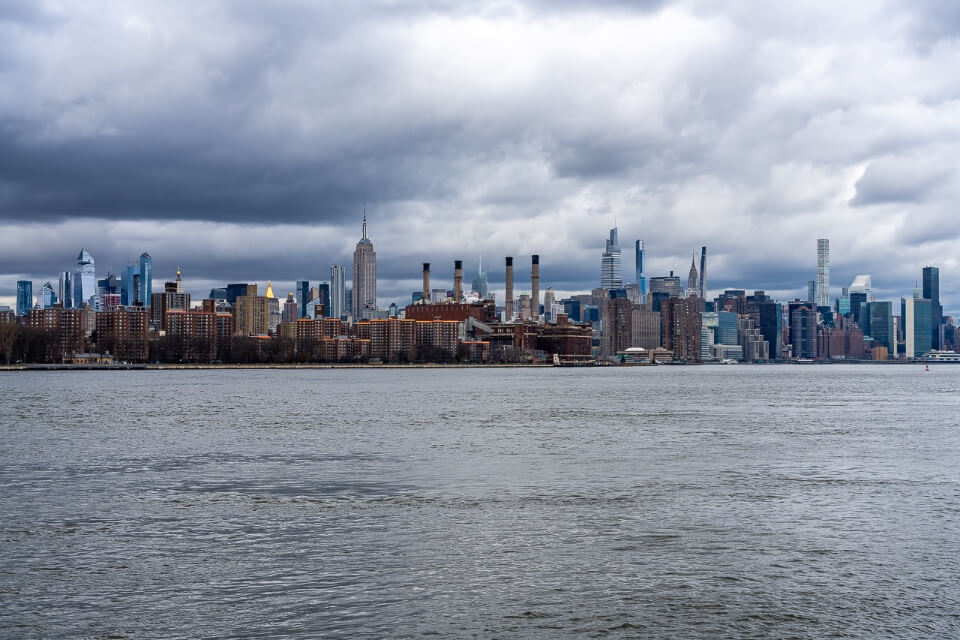 Midtown Manhattan skyline over the East River from Domino Park in Williamsburg NYC awesome photo