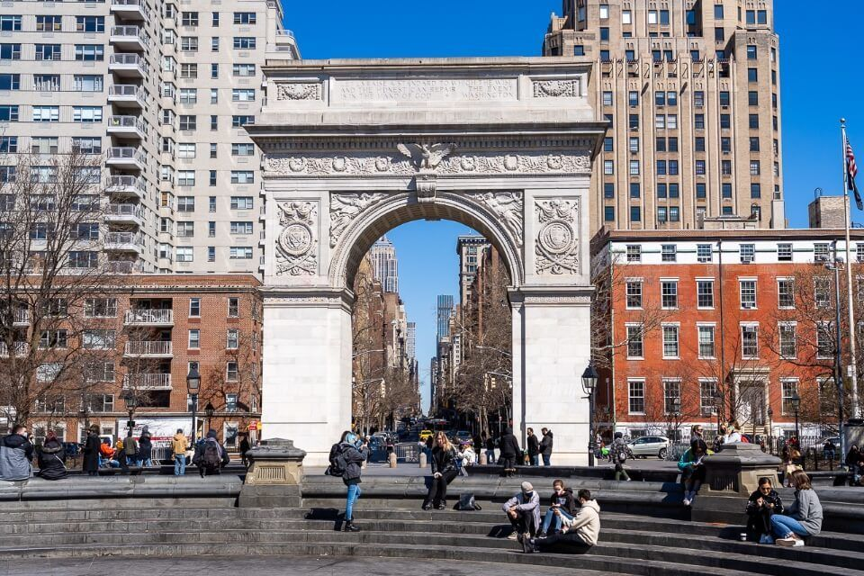 Washington Square Arch in midtown manhattan frames the road toward empire state building