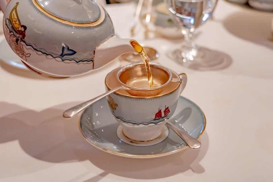 Afternoon tea at the whitby hotel in nyc luxury thing to do and add to new york city itinerary teapot pouring hot water into teacup