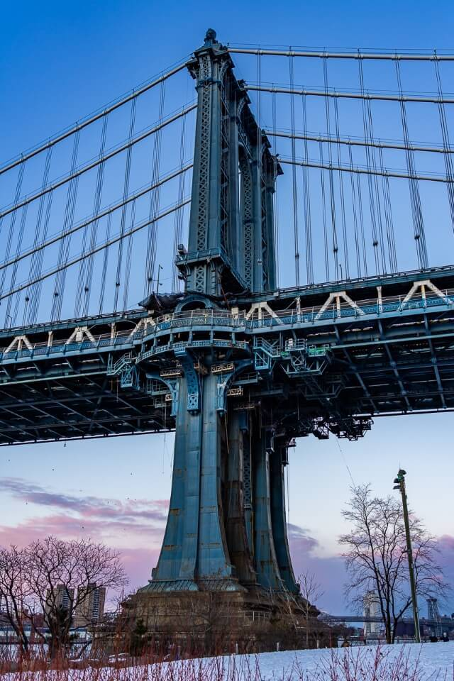 Manhattan bridge column from close looking enormous at sunset