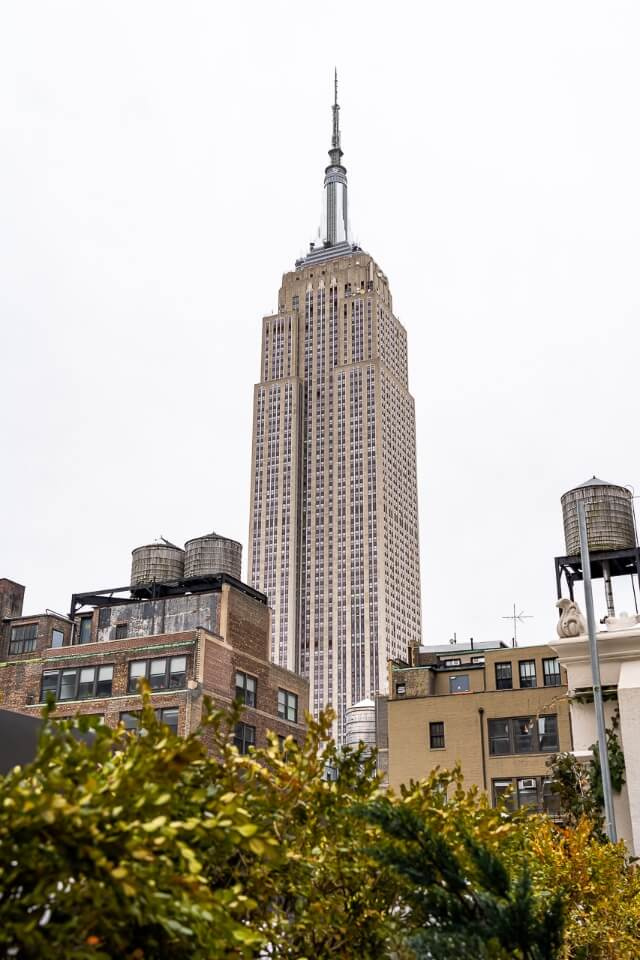 Empire state building from refinery rooftop bar in new york city