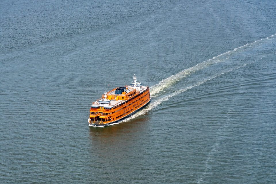 Take a free staten island ferry from manhattan to see statue of liberty orange ship from above