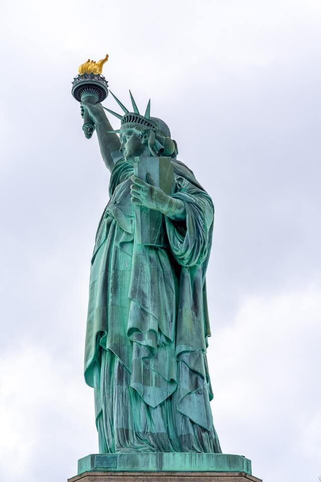 One of the very best things to do in New York City is take the ferry to statue of liberty on liberty island top bucket list attraction