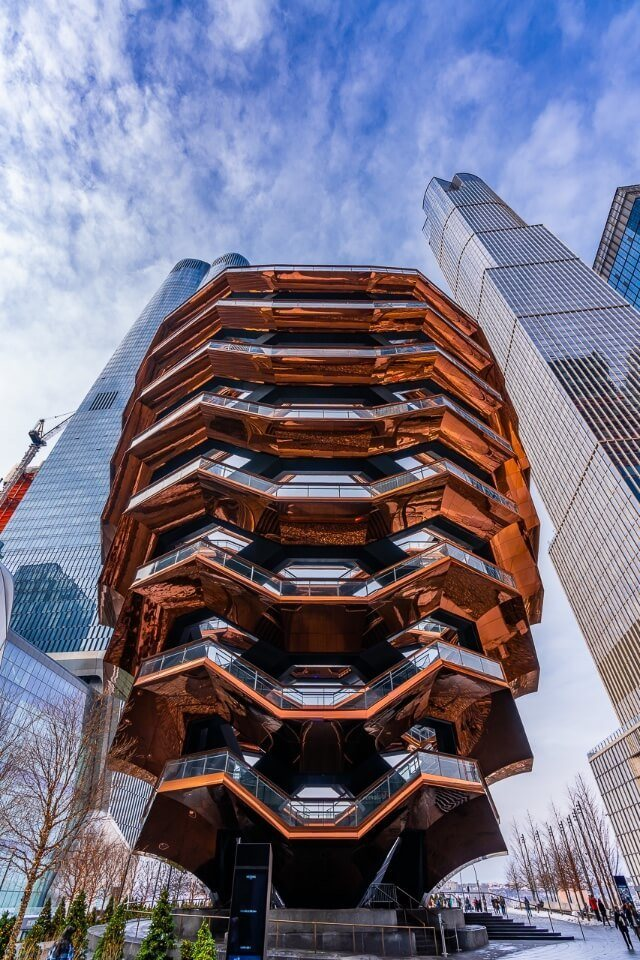Vessel orange metal structure in Hudson yards from below one of the most unique and best things to see in new york city