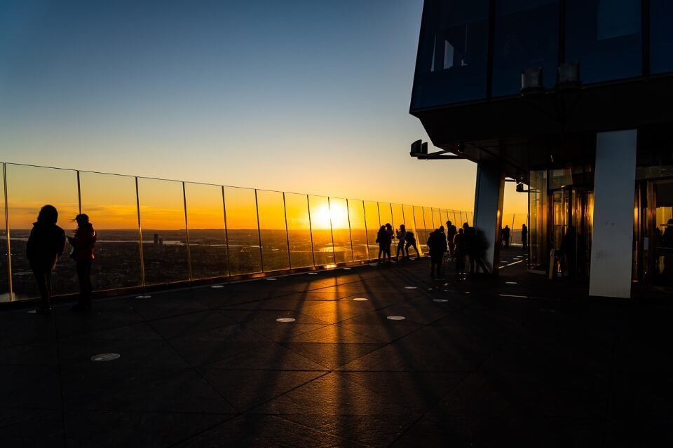 Sunset in new york city on top of hudson yards observation deck casting dark shadows