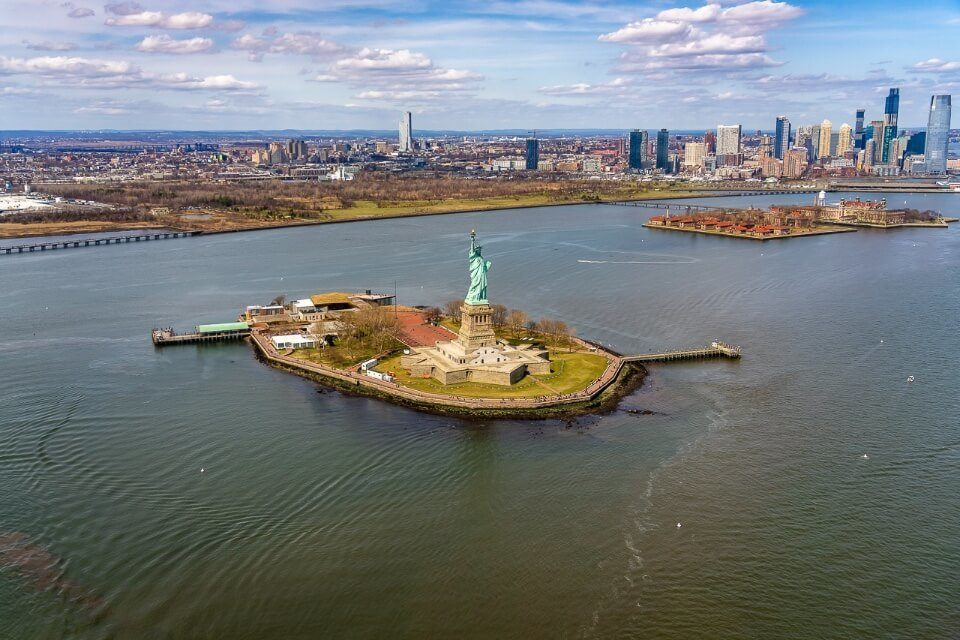 Statue of Liberty from above on a luxury tour over Manhattan