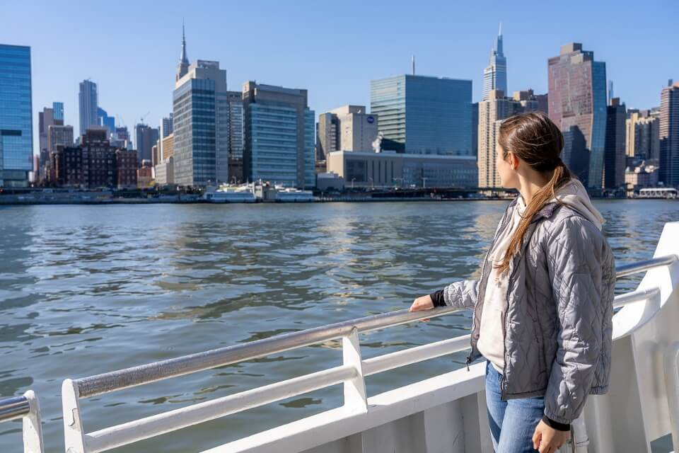 Standing on the side of a boat tour looking at the city skyline circle line