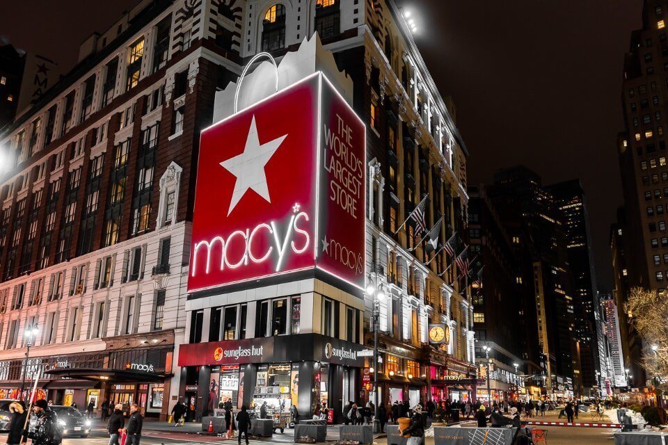 Macy's department store in new york city at night lit up red is a must visit for first time tourists