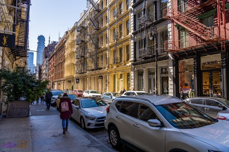 Soho colorful building facades and cobblestone streets one of the best NYC neighborhoods to explore on a first visit to new york city