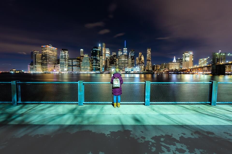 New York City skyline is amazing during the day but even more impressive at night from Brooklyn Bridge park overlooking lower manhattan