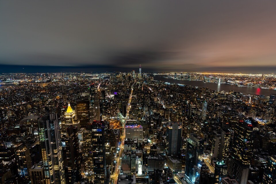 Midtown Manhattan South of the Emire state building at night with bright lights
