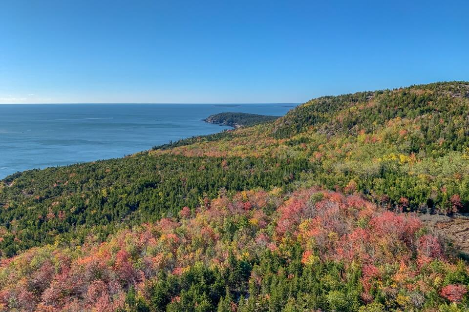 Acadia National Park in Fall with stunning colors from the summit of Beehive Trail hike