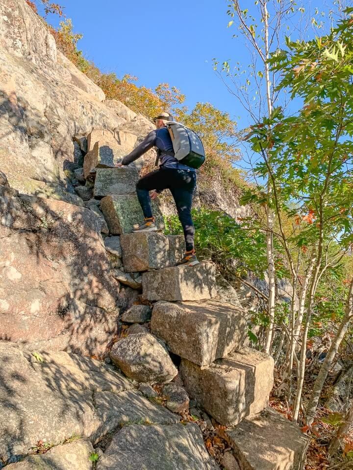 Man climbing steps on a cliffside