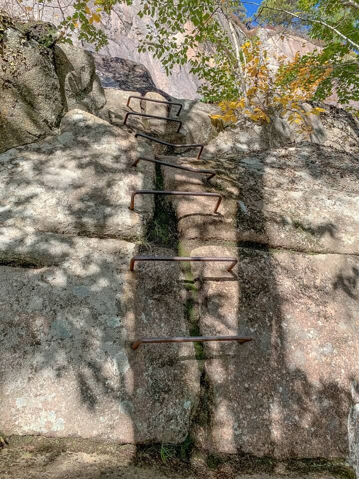 Iron rung ladder protruding out of granite rock in Maine