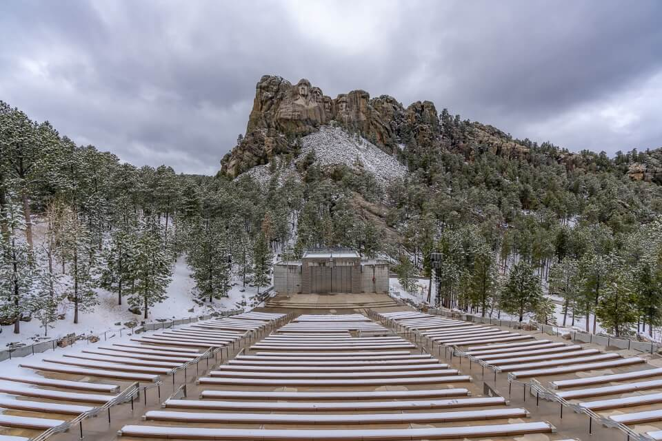 Mt Rushmore amphitheater seating empty on a cold snowy cloudy day