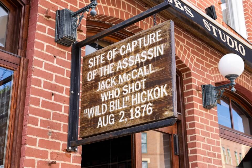 A quick visit to deadwood south dakota is a fun family thing to do near mount rushmore see the sign marking where wild bill Hickok was shot
