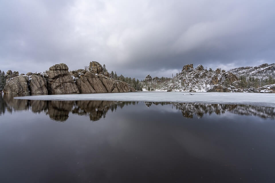 Sylvan Lake in south dakota black hills with reflection and ice sheet one of the best things to do near mount rushmore
