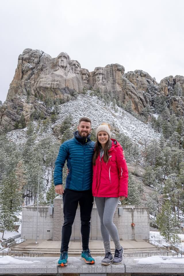 Where are those morgans standing in front of mount rushmore national memorial amphitheater on a cloudy snow day