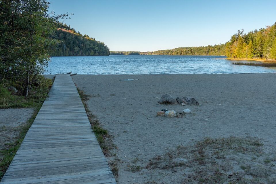 Echo Lake boardwalk beach and water in shadow in late afternoon