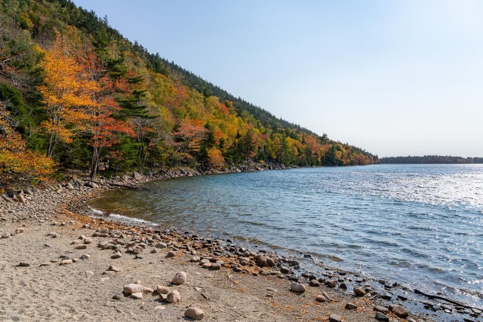 Jordan Pond surrounded by stunning colors fall foliage trees